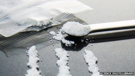 A spoon and a bag with white powder - cocaine