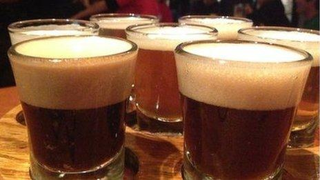 Seven glasses of beer on a platter