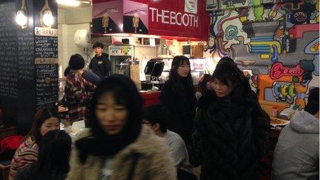 A crowded bar in Seoul full of young people