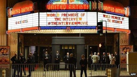 """Security is seen outside The Theatre at Ace Hotel before the premiere of the film """"The Interview"""" in Los Angeles, California, on 11 December 2014"""