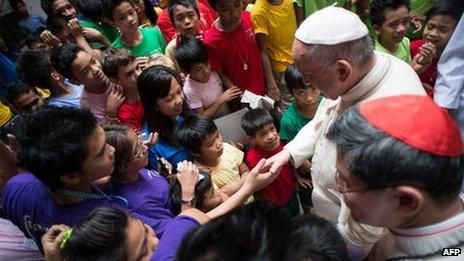 This handout picture released by the Vatican press office (Osservatore Romano) shows Pope Francis meeting children at an event in Manila on January 16, 2015.