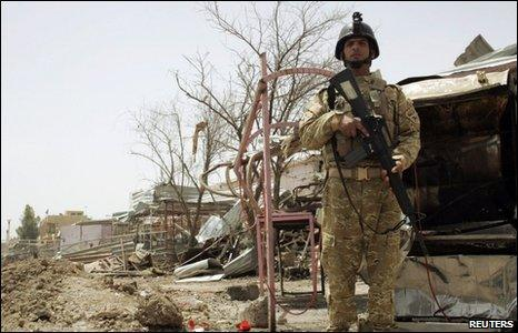 Iraqi soldier stands guard at bombed market in Khalis, 22/5/10