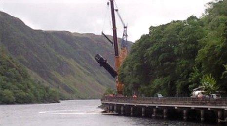 derailed train carriage lifted by crane
