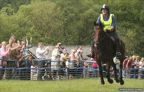 Llinos Mair Jones crosses the finishing line in triumph on Sly Dai in the 2010 Man v Horse race