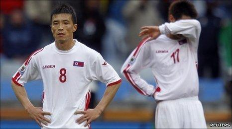 North Korea's Ji Yun-nam (L) and An Yong-hak at the final whistle
