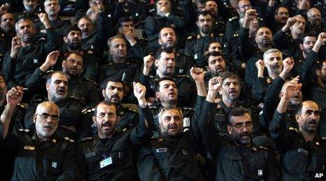 Iranian Revolutionary Guard commanders chant slogans during a meeting with President Mahmoud Ahmadinejad. File photo