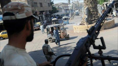 Pakistani soldier keep watch on a street in Karachi on October 21 2010