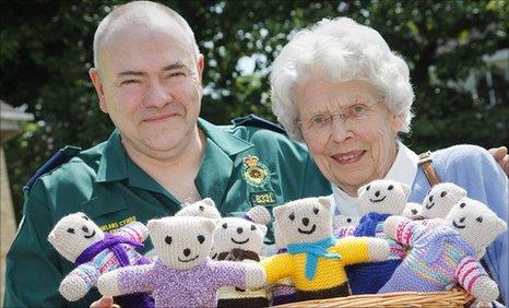 Paramedic Phil Williams with 'knitting nanna' Janet Speines at Welshpool ambulance station