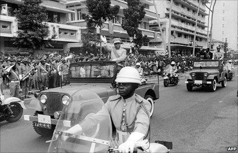 Joseph Kasavubu, first president DR Congo waves to the crowd, on 30 June 1960 during the celebrations of the 5th anniversary of independence in 1965 – the year he was ousted