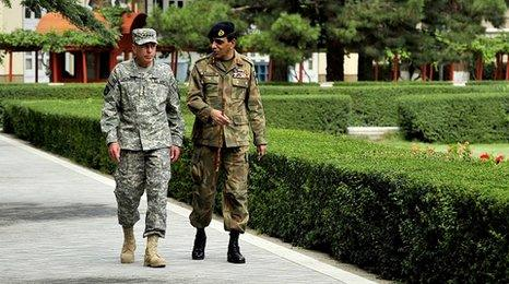Gen David Petraeus talks with Pakistan Chief of Army Staff Gen Ashfaq Kayani in the gardens of the Afghan Presidential Palace in Kabul (file picture 9 August)