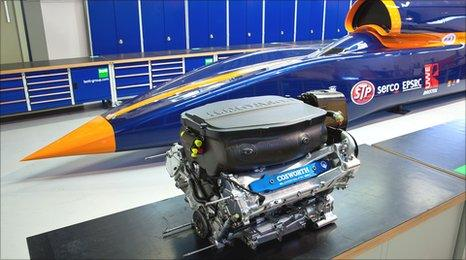 The Cosworth Formula One engine next to the Bloodhound.