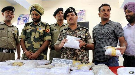 Indian police near Amritsar show 31kg of seized heroin