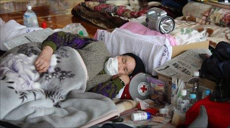 A woman catches up on sleep at a centre in Yamada, Iwate prefecture