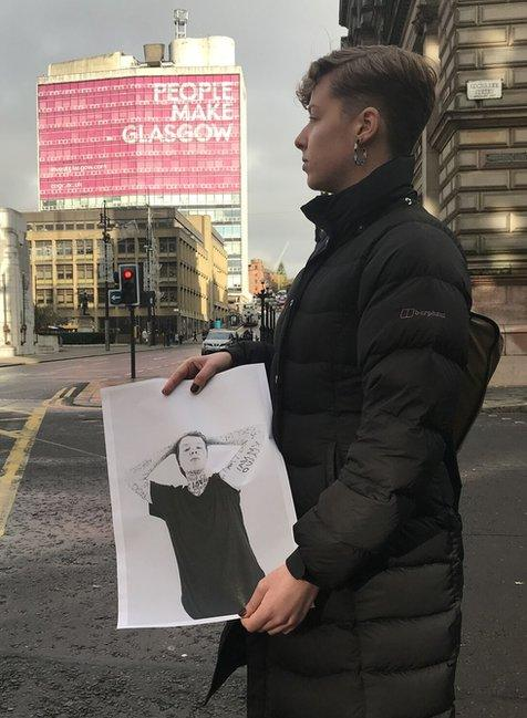 Eliza Coulson holding her photo
