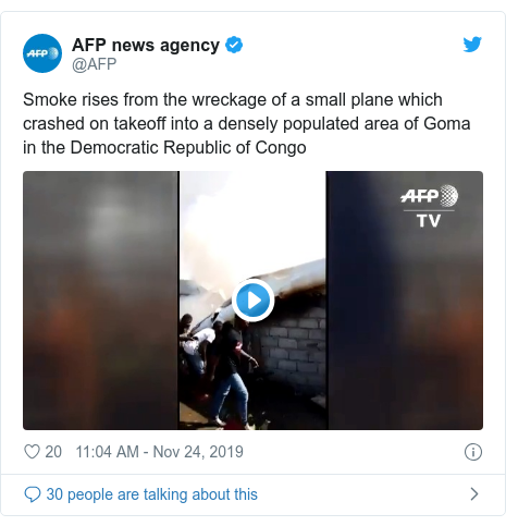 Twitter post by @AFP: Smoke rises from the wreckage of a small plane which crashed on takeoff into a densely populated area of Goma in the Democratic Republic of Congo