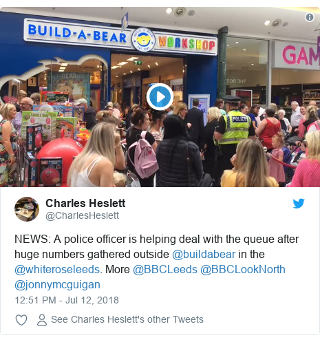 e4465a86211 Twitter post by  CharlesHeslett  NEWS A police officer is helping deal with  the queue