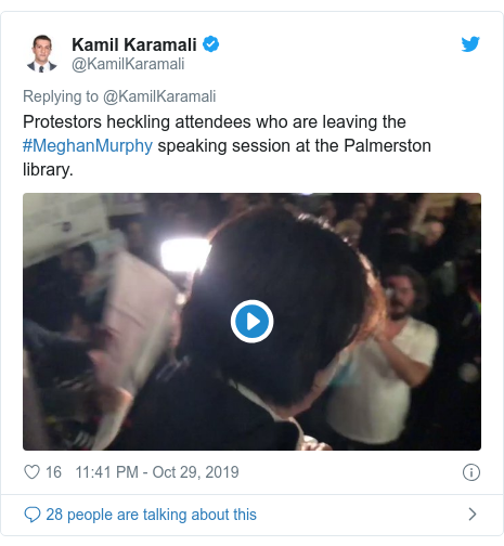 Twitter post by @KamilKaramali: Protestors heckling attendees who are leaving the #MeghanMurphy speaking session at the Palmerston library.