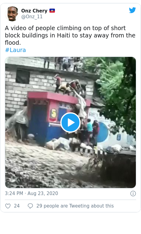 Twitter post by @Onz_11: A video of people climbing on top of short block buildings in Haiti to stay away from the flood.#Laura