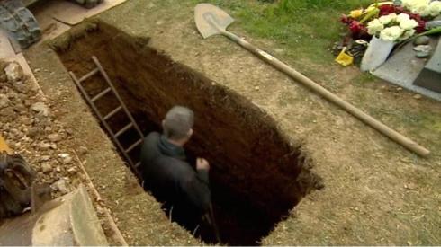 gravedigger digging a grave