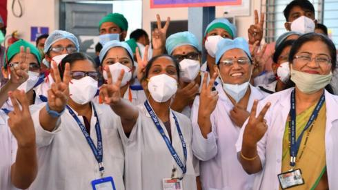 Doctors of the Rajawadi Hospital make the victory sign as they wait for the start of the Covid-19 coronavirus vaccination drive in Mumbai on January 16, 2021.