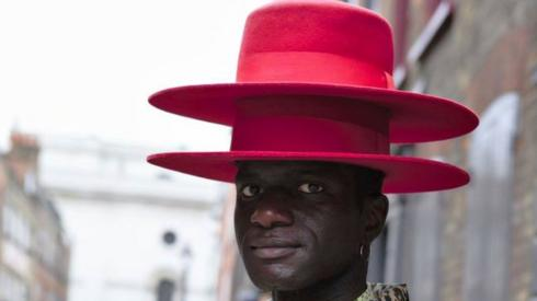 Man with two hats on top of each other