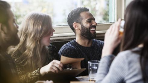 Friends enjoying a drink in a pub