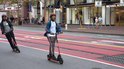Man riding electric scooter in San Francisco
