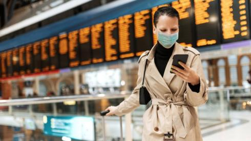 Business traveller looking at her phone