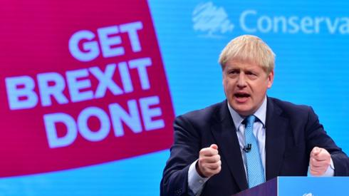 Boris Johnson (hand gestures, gesturing with hand) delivering his keynote speech (address) to the Conservative Party conference, at Manchester Central Convention Complex (commonly known as Manchester Central), on October 2nd 2019. Conference slogan in background reads: Get Brexit Done.