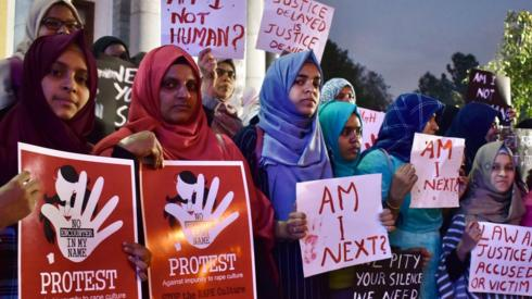 Activists from various women's rights organisations hold placards as they protest against sexual harassment, rapes and murders of women across the country urging the government to help uphold the women's rights, during a demonstration in Bangalore on December 11, 2019.