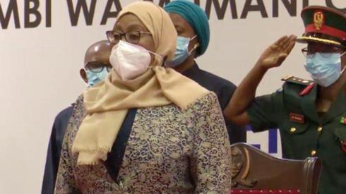 Samia Suluhu Hassan and officials behind wearing face masks in Dar es Salaam, Tanzania
