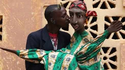 Man kissing a puppet
