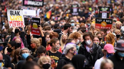 Protesters are seen during an Invasion Day rally in Melbourne, Australia, 26 January 2021