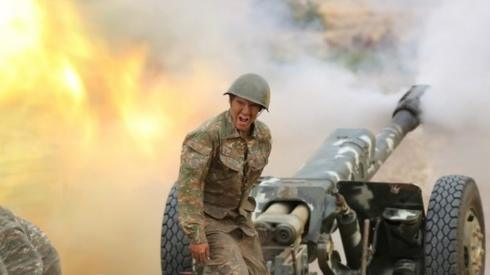 An ethnic Armenian soldier fires an artillery piece in Nagorno-Karabakh. Photo: 29 September 2020