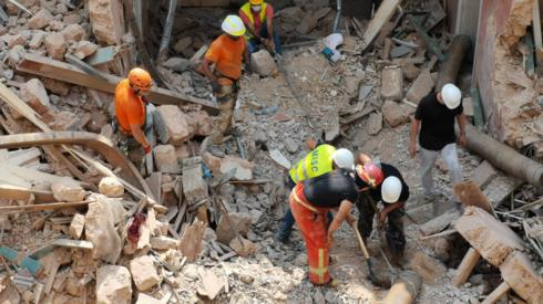 Rescuers search through debris in Beirut on 04 September