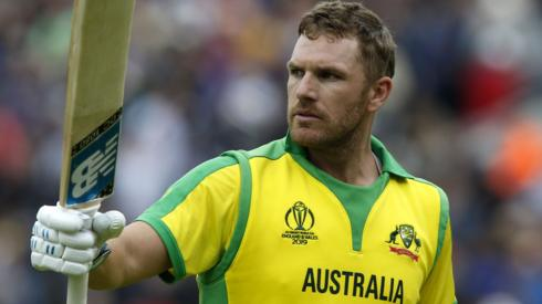 Aaron Finch holds his bat aloft after being dismissed