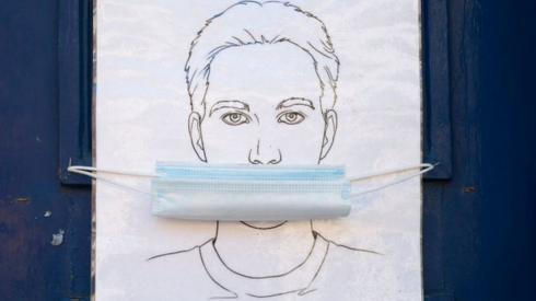 An illustration with a face mask