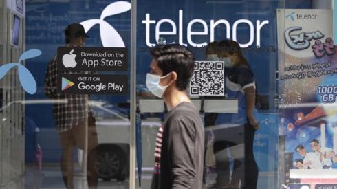 Man walks past Telenor showroom in Yangon, Myanmar, on 4 February 2021