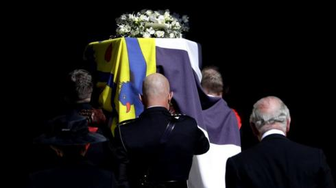 The Duke of Edinburgh's coffin, covered with His Royal Highness's Personal Standard is carried into St George's Chapel, Windsor Castle, Berkshire, followed by the Prince of Wales during the funeral of the Duke of Edinburgh.