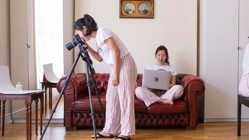 Multiple exposure of a photographer at home