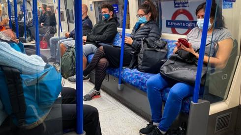 Commuters on a Tube at 08:01 in central London.
