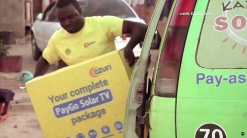 An Azuri solar satellite TV delivery man