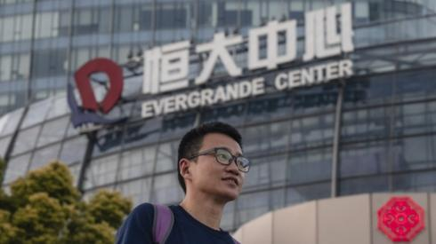 A man walks past the Evergrande Center in Shanghai, China.