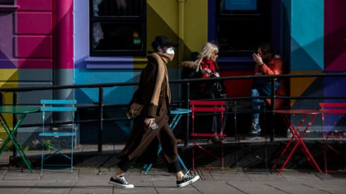 Woman in a mask in Brighton, UK