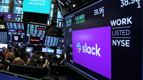 "The stock price of Slack Technologies Inc. trading under the symbol (WORK) is seen on a display above the floor of the New York Stock Exchange (NYSE) during the company""s direct listing in New York, U.S. June 20, 2019"