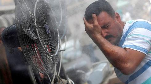 Man cooling off in Baghdad