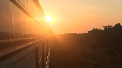 The sun pictured behind a Tazara train travelling from Tanzania to Zambia
