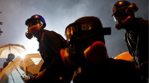 An anti-government protester holds a molotov cocktail during clashes with police outside Hong Kong Polytechnic University (PolyU) in Hong Kong, China, November 17, 2019.