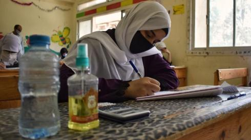 A secondary student sitting an exam
