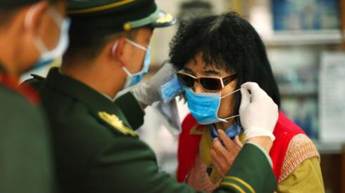 Chinese soldiers and social workers spread epidemic prevention knowledge to residents in Shenzhen, Guangdong Province, February 7, 2020